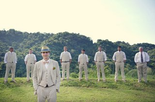 groom-with-groomsmen-in-tropical-landscape-and-vests
