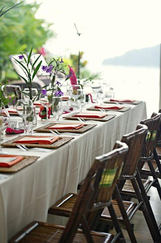 long-reception-table-with-wooden-chairs-for-beach-wedding
