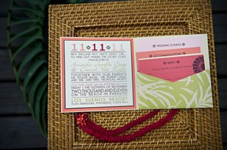tropical-wedding-invite-on-top-of-rattan-charger
