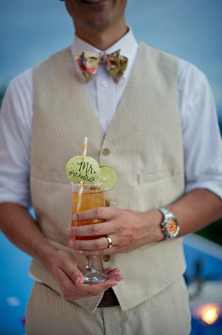 groom-holding-michelada-cocktail-with-special-straw
