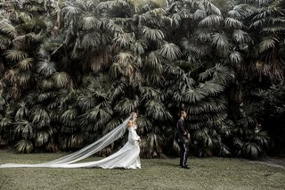 bride-in-daughters-of-simone-wedding-dress-co-owner-ashley-walking-toward-groom-for-first-look-italy