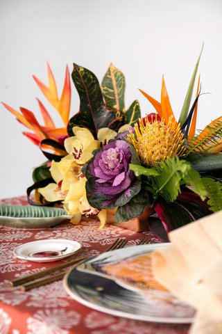 wedding-reception-tropical-table-with-purple-green-brassica-cabbage-yellow-protea-bird-of-paradise