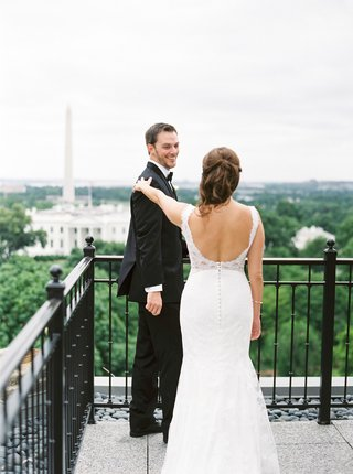 bride-in-wedding-dress-with-beaded-back-low-scoop-back-lace-groom-in-tuxedo-first-look-washington-dc