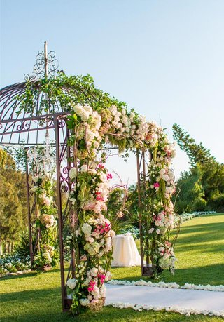 gazebo-used-by-wedding-chuppah-decorated-with-flowers-and-greenery