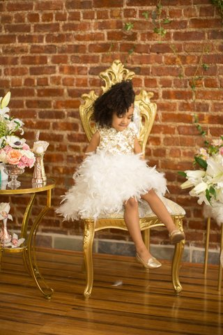 pantora-mini-flower-girl-dress-with-white-feathers-for-skirt-and-gold-detail-on-bodice