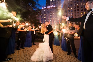 bride-and-groom-in-vera-wang-kiss-surrounded-by-sparklers