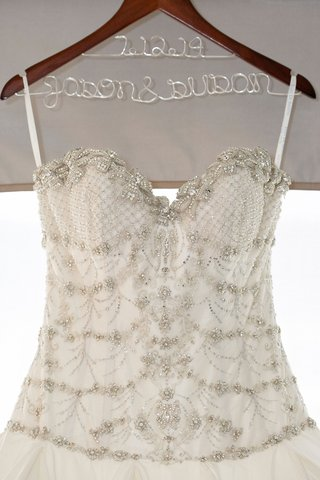 close-up-of-an-ines-di-santo-gown-with-sequins-beading-crystals-decorating-the-bodice