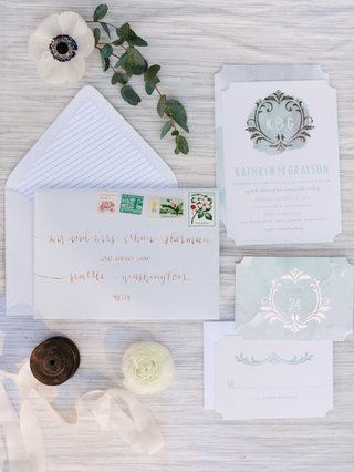 blue-white-and-rose-gold-watercolor-invitation-suite-with-blooms-and-leaves