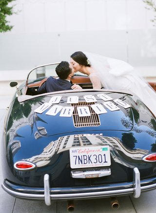 bride-kissing-groom-in-just-married-car-porsche-356-speedster-california-license-place