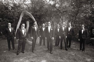 black-and-white-photo-of-groom-and-groomsmen-in-tuxedos-with-black-and-white-bow-ties