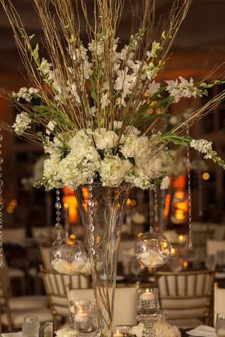 towering-vase-with-gold-branches-white-stock-hydrangeas-orchids-crystal-strands-globes