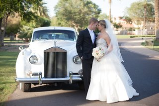 bride-in-anne-barge-ball-gown-and-veil-with-groom-in-black-tuxedo-white-rolls-royce