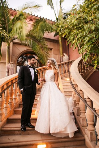 outdoor-wedding-venue-grand-staircase-grand-del-mar-high-neck-hayley-paige-wedding-dress-groom-tux