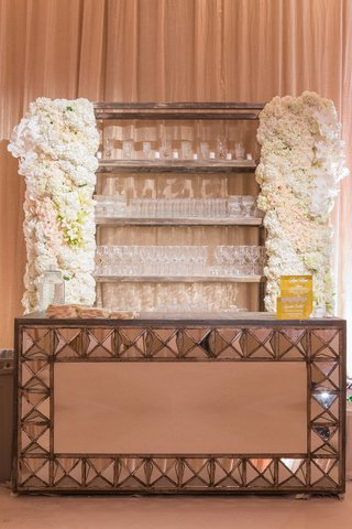 mirror-bar-with-rock-studs-and-white-flower-design