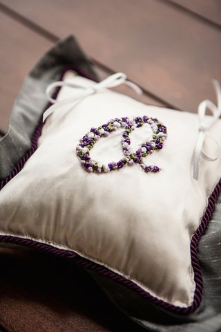 purple-cord-on-white-ring-pillow-with-monogram-o-in-flower-appliques