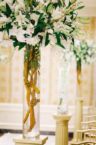 wedding-ceremony-with-bouquet-of-ivory-stargazer-lilies-and-orchids-in-a-cylider-vase-decorate-aisle