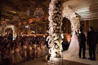 wedding-ceremony-white-flowers-stage-rabbi-the-plaza-hotel-wedding-ceremony
