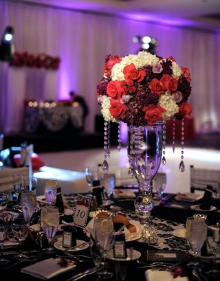red-and-white-flowers-on-damask-tablecloth