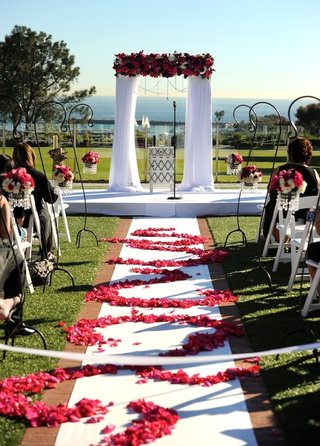 white-aisle-with-patterned-petals-and-wedding-canopy
