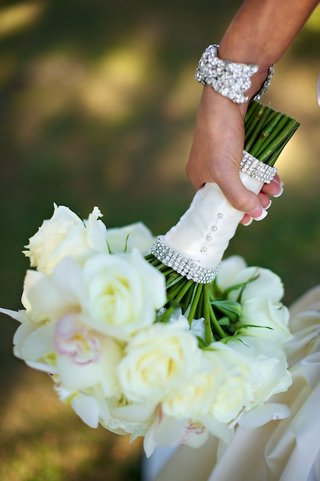 white-roses-and-pink-florals-wrapped-in-ribbon