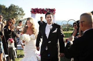 bride-and-groom-holding-hands-exit-wedding