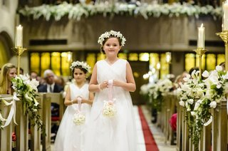 flower-girls-in-white-dresses-with-head-wreaths-and-pomanders
