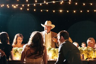 texan-man-in-cowboy-hat-standing-up-at-table