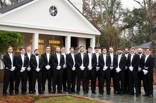 groom-and-groomsmen-in-tuxedos-white-tie-and-gloves-white-vest-black-suit-formal-new-years-eve