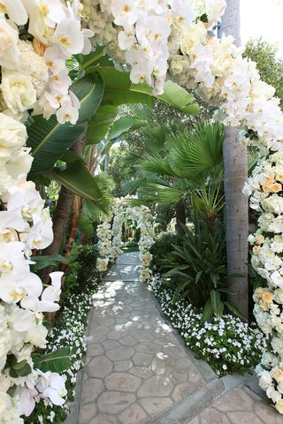 arches-of-flowers-along-stone-pathway