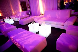 white-wedding-lounge-chairs-with-fuchsia-lighting