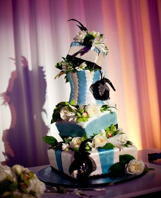 blue-and-white-tiltilng-cake-with-black-flowers