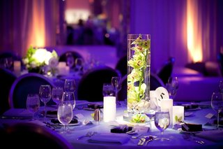 lime-green-flowers-in-cylinder-vase-at-purple-wedding