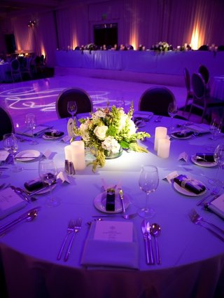bright-purple-lighting-on-wedding-reception-table