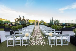 the-london-west-hollywood-rooftop-ceremony-rose-petals-on-aisle-white-folding-chairs
