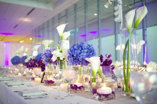 long-wedding-table-with-blue-hydrangea-and-purple-flowers