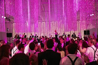 wedding-guests-dancing-in-pink-reception-room
