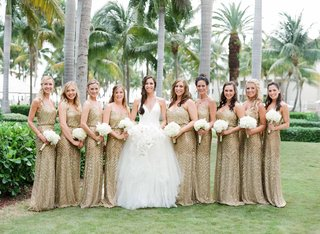 bride-in-white-halter-v-neck-vera-wang-wedding-dress-with-bridesmaids-in-gold-sequin-dresses