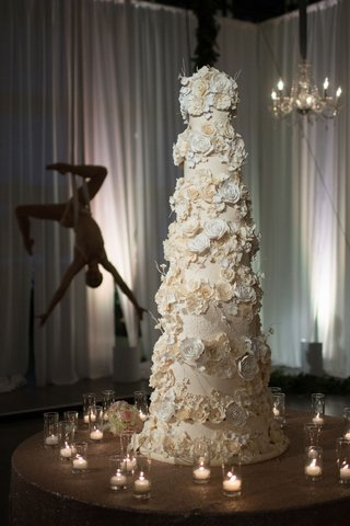 seven-layer-cake-with-sugar-flowers-acrobat-in-background-aerial-dancer-candle-votives