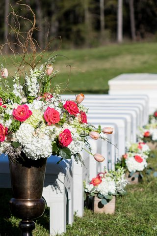 white-benches-at-outdoor-ceremony-with-boxes-and-urns-of-white-hydrangea-and-pink-flowers