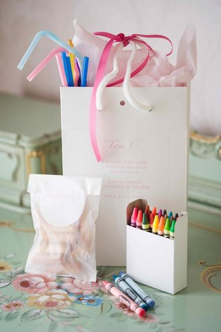 white-gift-bag-filled-with-straws-and-crayons