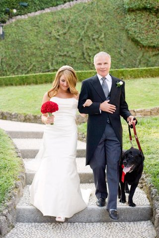 bride-and-groom-walking-black-dog-down-aisle