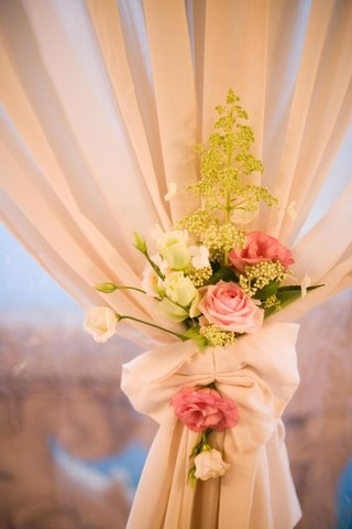 green-plant-and-pink-rose-flowers-on-ivory-drapes