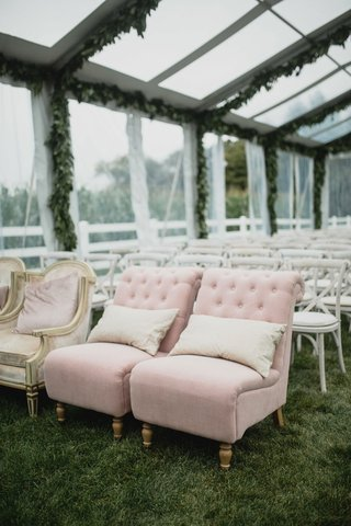 wedding-guest-seating-tent-wedding-ceremony-grass-lawn-clear-tent-pink-slipper-chair-tufted-antique