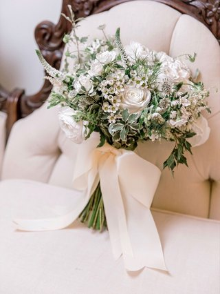 bridal-bouquet-soft-greenery-white-flowers-rose-and-additional-blooms-tied-with-white-ribbon