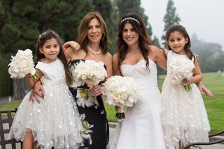 bride-with-mother-of-bride-and-two-daughters-in-tulle-polka-dot-skirts-dresses