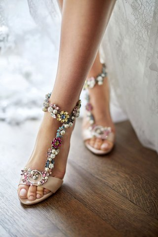 bride-with-pedicure-and-wedding-shoes-pretty-jimmy-choo-pink-sandals-with-blue-yellow-pink-white