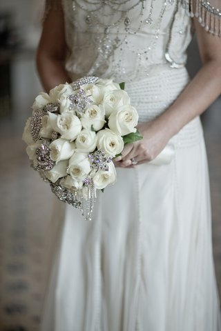 brides-bouquet-of-white-roses-and-rhinestone-broaches