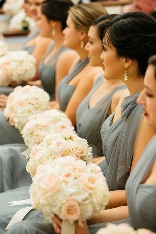 bridesmaids-in-grey-blue-dresses-with-round-white-and-pink-wedding-flower-bouquets