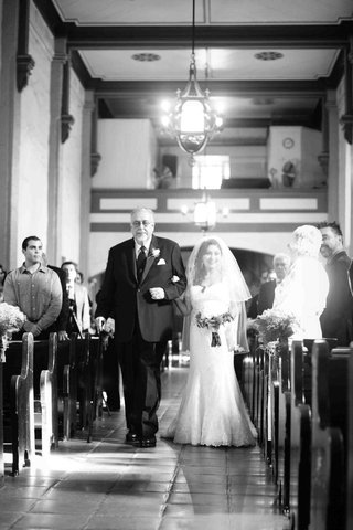 black-and-white-photo-of-man-with-cane-escorting-bride