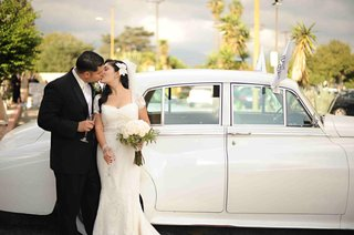 bride-and-groom-kissing-by-rolls-royce